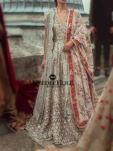 Beautiful Pakistani Wedding Gown And Sharara Outfit For Brides In Tan Color
